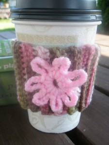 Crocheted Coffee Cozy in Pink Camo with Pink Flower
