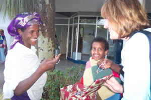 Sue Helping Two Patients Pick Out Bracelets at the Fistula Hospital